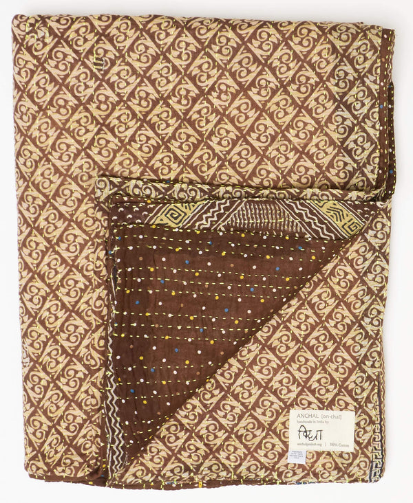 One-of-a-kind kantha twin quilt with white geometic patterning and a yellow kantha stitch