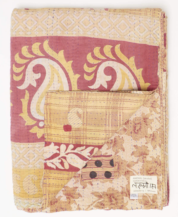 Fair trade orange and red twin quilt handstitched by an Anchal Artisan in Ajmer India