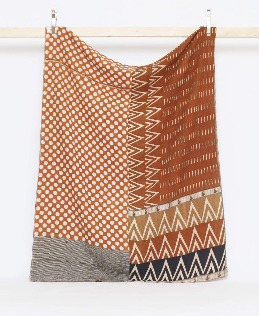 Brown vintage twin quilt with white modern geometric patterns and blue kantha stitching