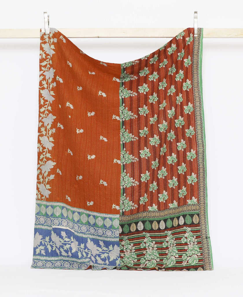 Brown and Green vintage twin quilt with green and blue floral and leaf patters with yellow kantha stitching