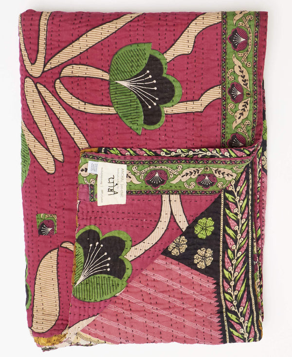 Fair trade pink kantha twin quilt handstitched by Anchal artisans in Ajmer India with floral and striped patterns