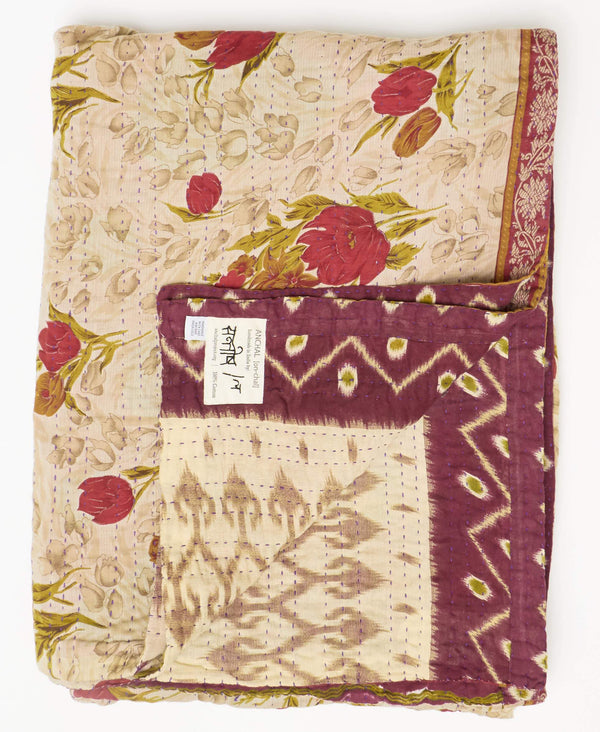 Fair trade tan and maroon kantha twin quilt handstitched by Anchal artisans in Ajmer India with floral and triangle patterns