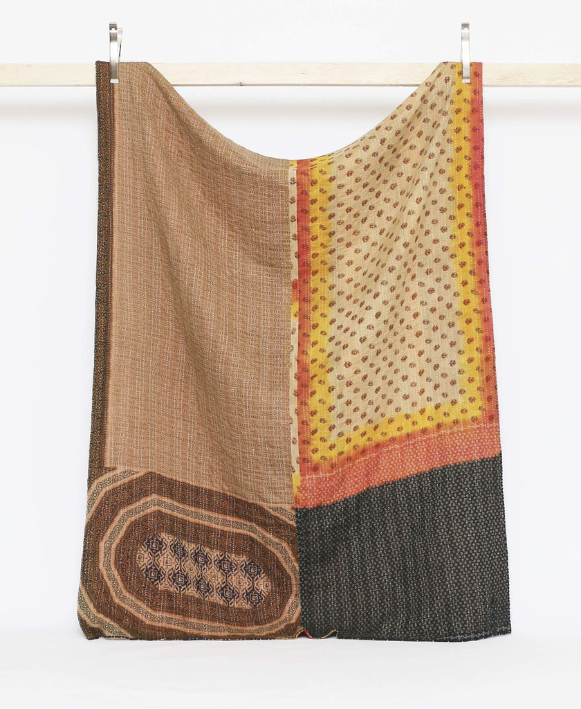 Brown and orange vintage twin quilt with bright yellow detailing with white kantha stitching