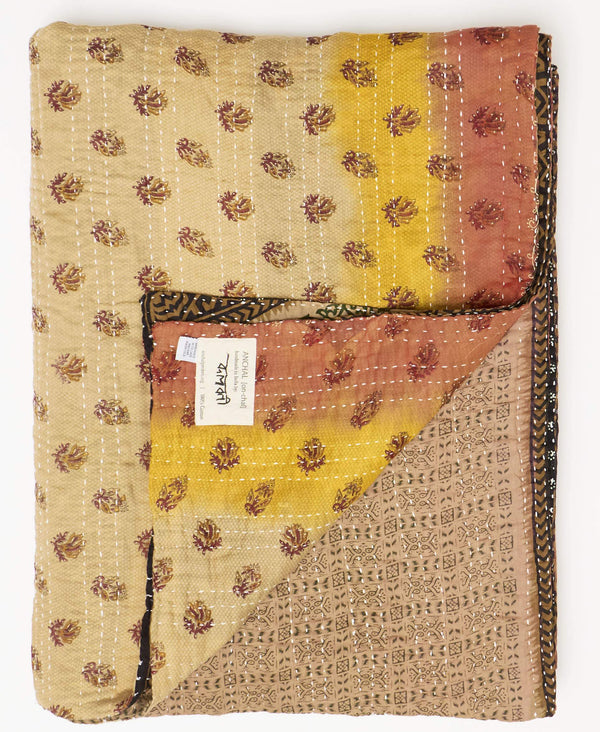 Fair trade brown and orange kantha twin quilt handmade by Anchal artisans in Ajmer India with paisley and geometric patterns