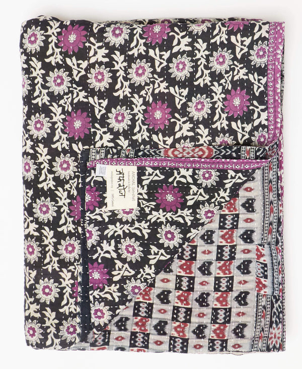 Fair trade purple twin quilt handstitched by Anchal artisans in Ajmer India with floral patterns