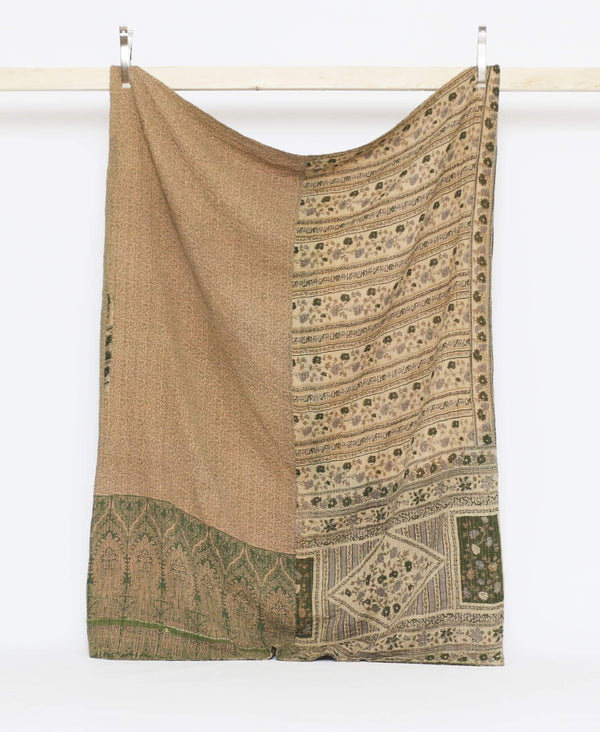 Minimalistic brown and green vintage twin quilt with green and gray floral detailing with pink kantha stitching