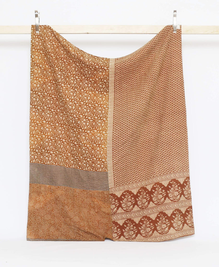 Twin quilt throw in orange and rust with multiple patterns from vintage saris