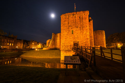 Harvest moon over Rothesay Castle