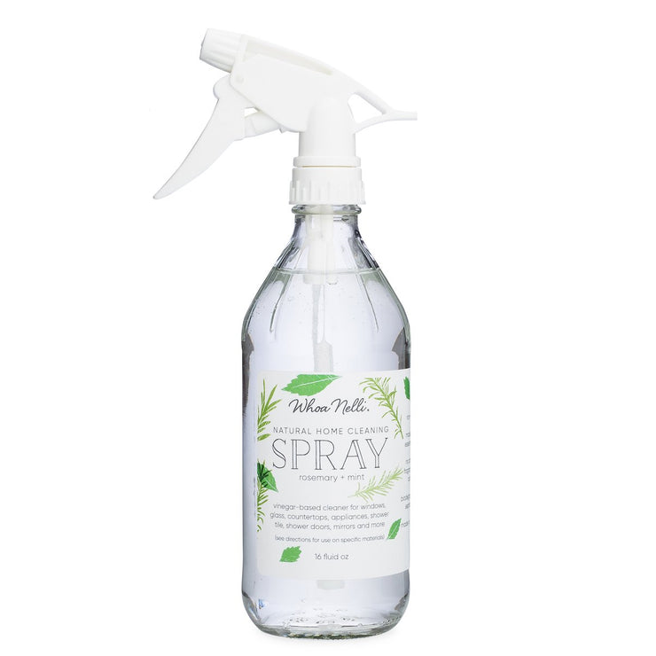 Natural all purpose cleaner in a glass spray bottle with a white spray trigger