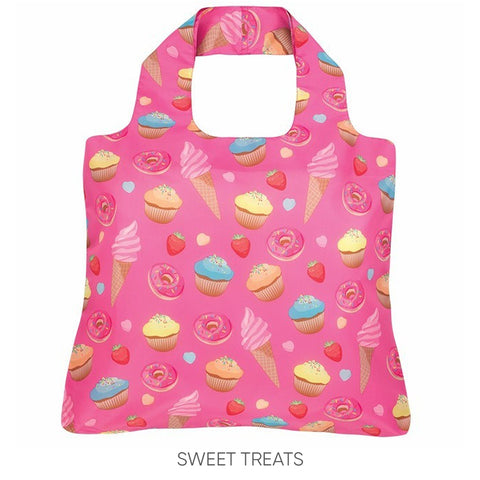 A reusable shopping bag with a bright pink background covered in a repeating pattern of drawn ice-cream cones, donuts and other sweets
