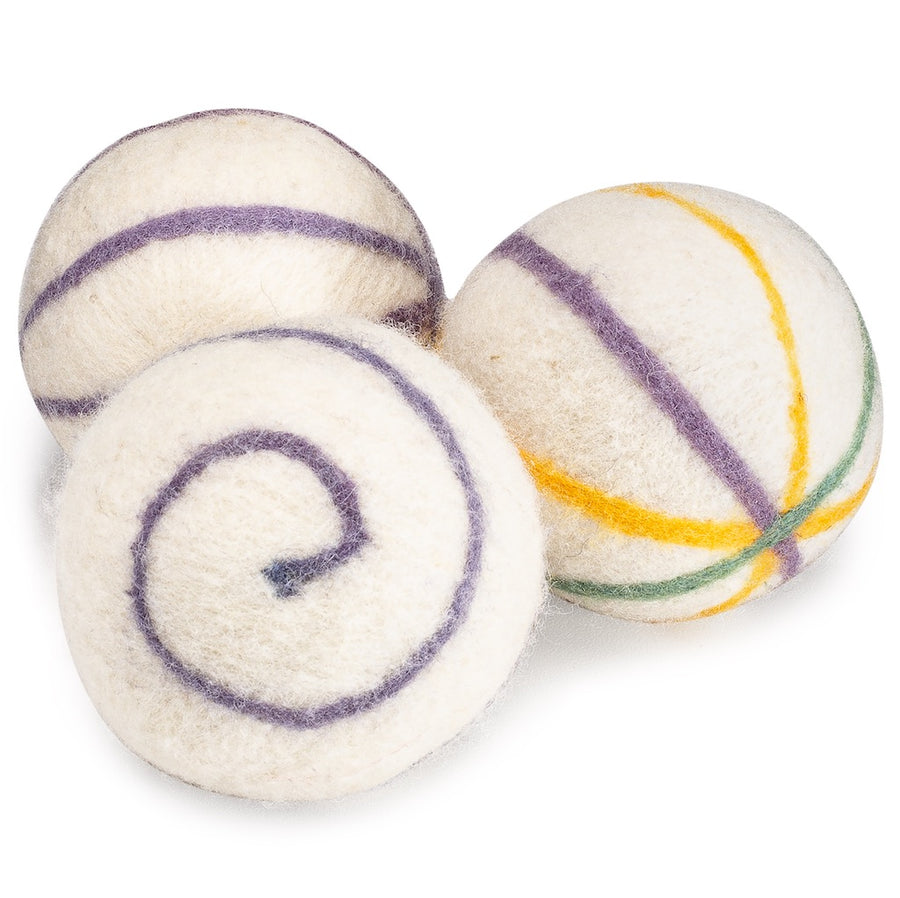 Three wool dryer balls with naturally dyed stripe and swirl patterns in purple, yellow and green