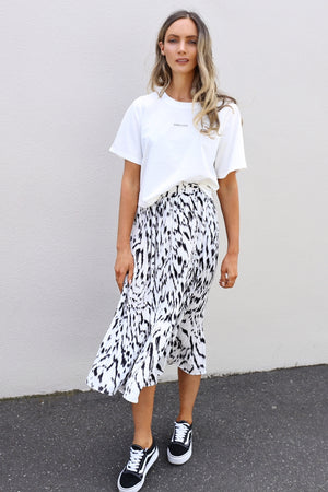 reyes pleated midi skirt mve boutique