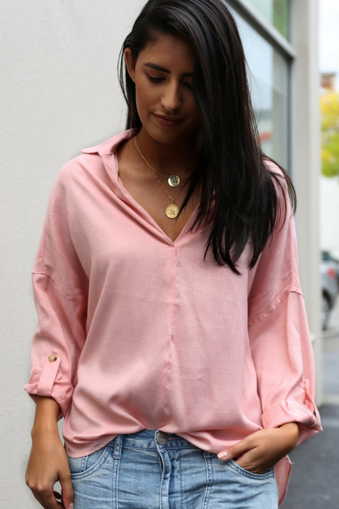 Lois Shirt is a pink pull over shirt with a collar