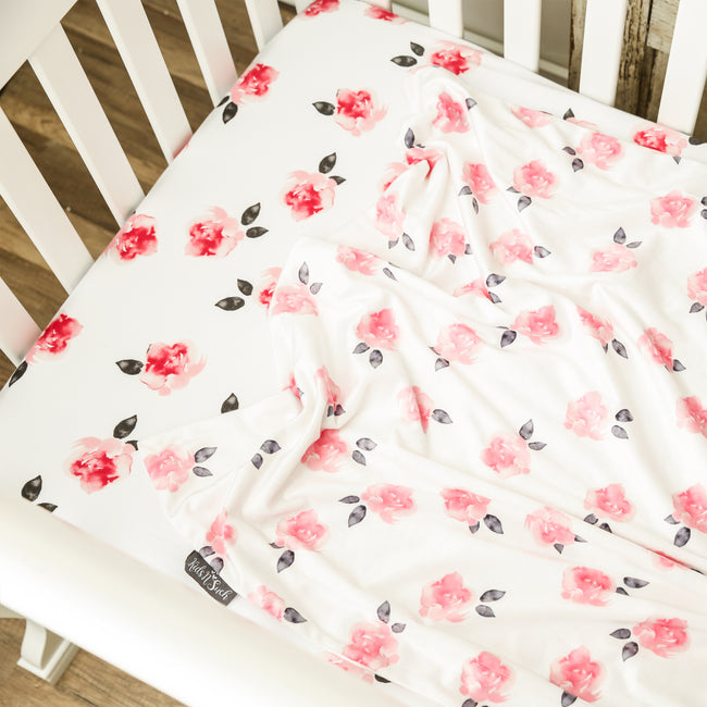 Minky baby blanket in red and pink petals print