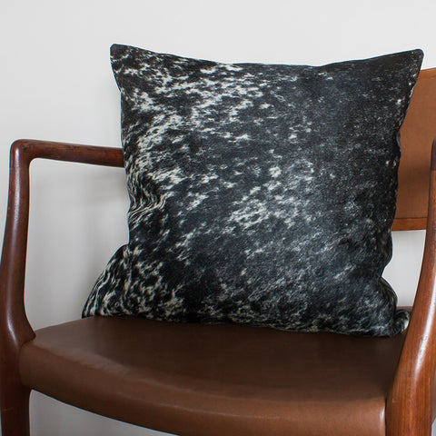 black white cowhide cushion