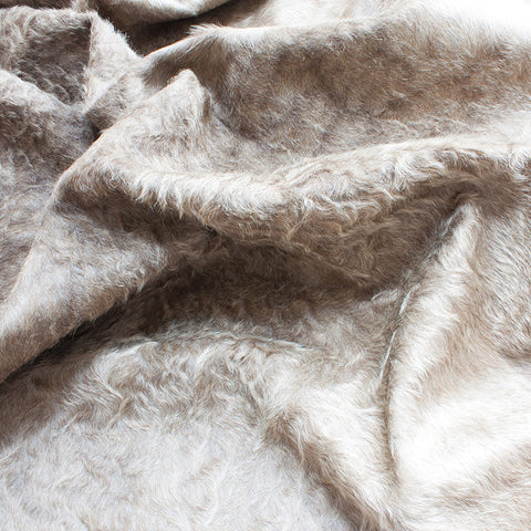 cowhide rug - curly taupe
