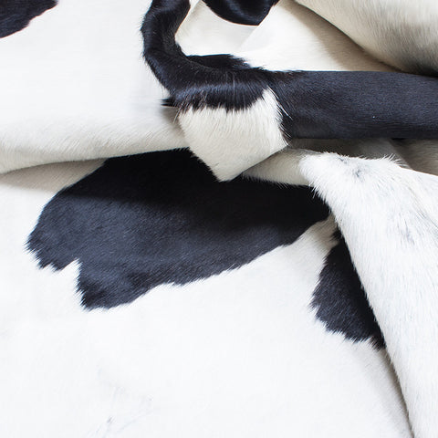 cowhide rug black with white spots