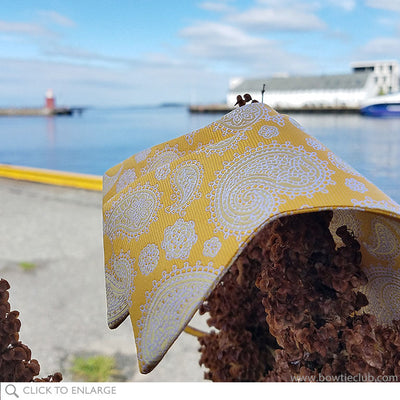 Yellow and White Silk paisley bow tie on dock in Alesund Norway