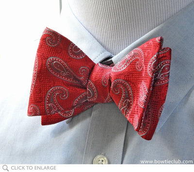 red paisley bow tie on shirt