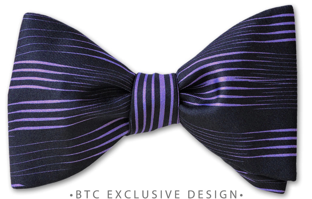 purple lines on ink blue bow tie