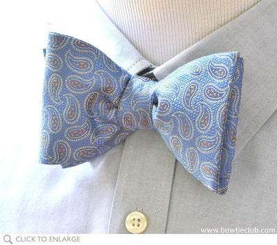 Soft blue paisley bow tie on shirt