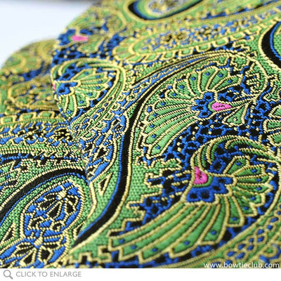 close up of green paisley bow tie