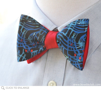 blue swirl bow tie on shirt
