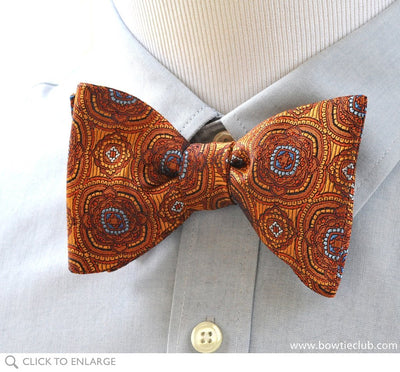 orange medallion bow tie on shirt