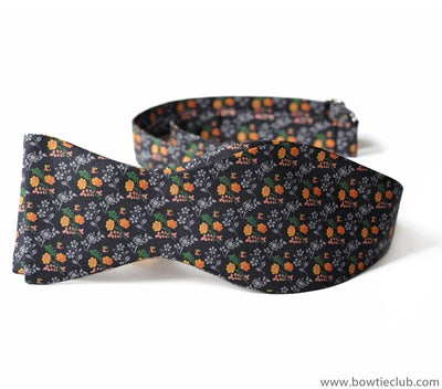 orange flowers on bow tie