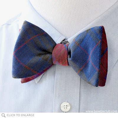 Kettlewell British Woven Wool Bow Tie In Brown, Red, Green and Purple on model.