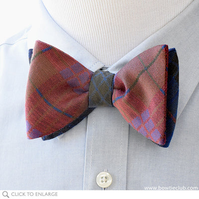Kettlewell British Woven Wool Bow Tie In Brown, Red, Green and Purple on blue pinpoint
