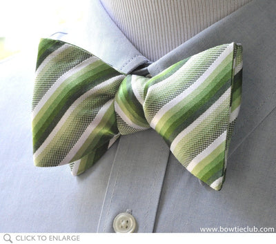 green stripe bow tie on blue shirt
