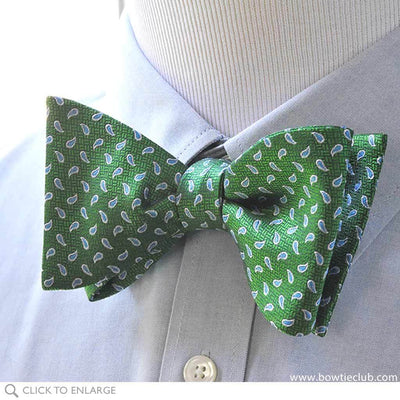 green teardrop bow tie on shirt