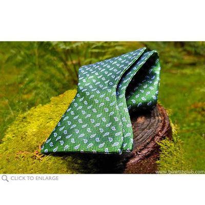 green teardrop bow tie in a field