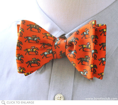 orange horse racing bow tie on shirt