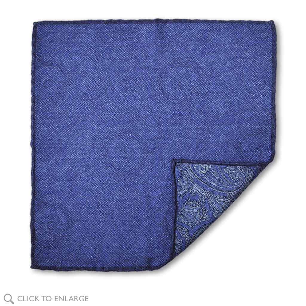Two sided pocket square in cashmere showing blue herringbone side