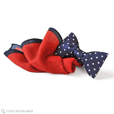 a perfect pairing of navy polka bow tie and red wool pocket square