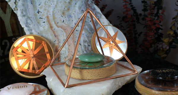 copper pyramid with gemstone word stone