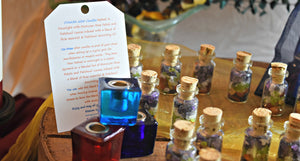 Chakra Ritual Candle Bundle with Mini Glass Bottle of Gemstone Chips and Candle Holder; FB1088