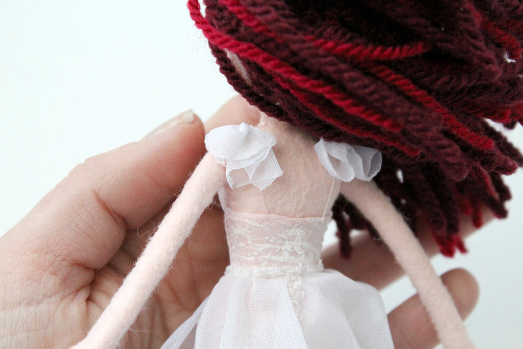 the back of the wedding dress on doll