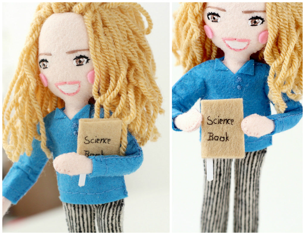 felt doll with science book