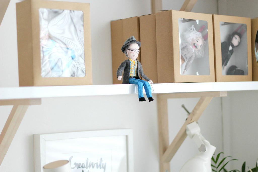 Gerard's doll sat on the shelf, selfie doll