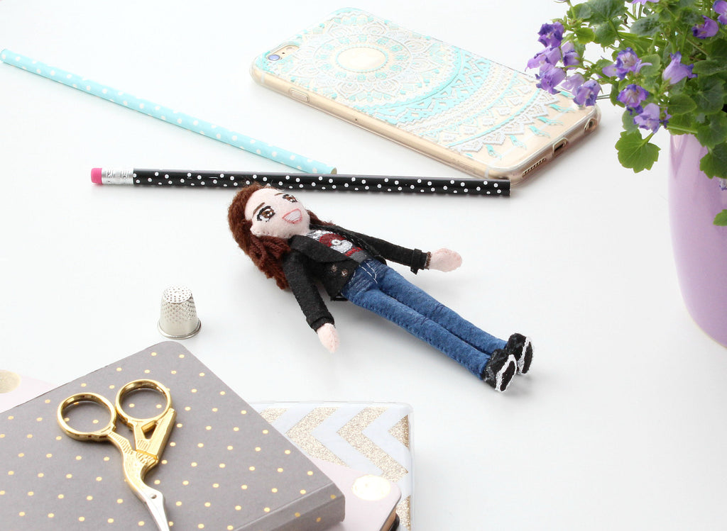 Brianna's doll on my desk among stationary, made by whisper of the pipit