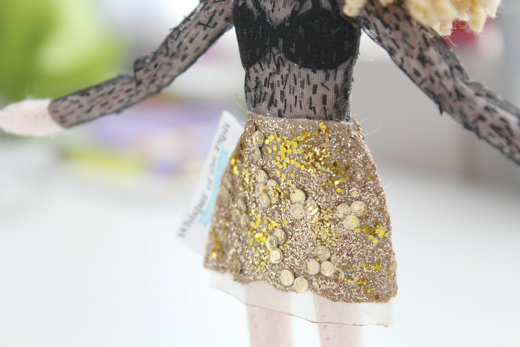 sequin skirt on hand-size doll