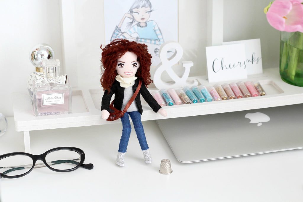 doll on a desk. Selfie dolls.