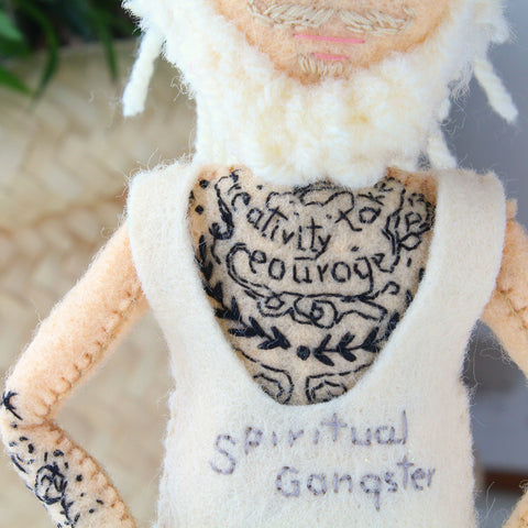 embroidered tattoo on a doll