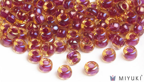 Cranberry-lined Topaz AB 6/0 Glass Beads