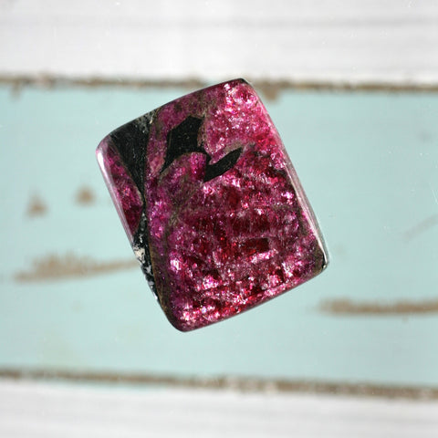 Eudialyte both sides polished iridescent pebble-cabochon pocket stone