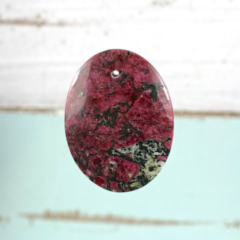 Eudialyte both sides polished drilled pebble-cabochon - Rusmineral cabochons&jewelry
