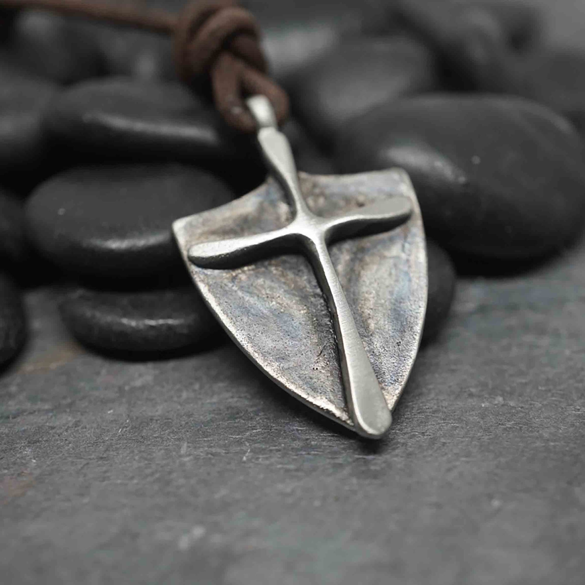 Pewter cross on shield style pendant made of pewter